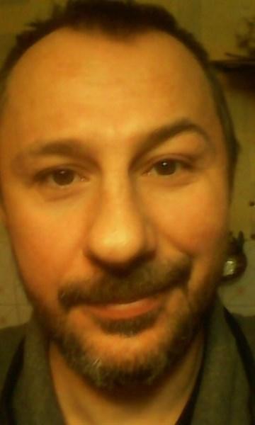 """Экс-горловский боевик """"ДНР"""" показал на фото, как топчет украинский флаг"""